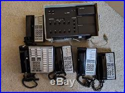 Merlin 410 business office phone system with 5 telephones (READ Description)